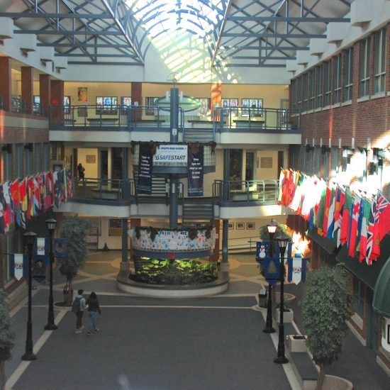 Artifacts: Flags of the Nations (value unknown)/Upper right: large cross of Risen Christ, Bust  of Father Troy located directly beneath it under canopy/second level in center, houses the chapel & 6 stained glass panels of Creation/all along the foyer under flags on left are hung The Stations of the Cross.